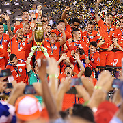 EAST RUTHERFORD, NEW JERSEY - JUNE 26:  Chile players celebrate their victory at the trophy presentation after their penalty shoot out win during the Argentina Vs Chile Final match of the Copa America Centenario USA 2016 Tournament at MetLife Stadium on June 26, 2016 in East Rutherford, New Jersey. (Photo by Tim Clayton/Corbis via Getty Images)