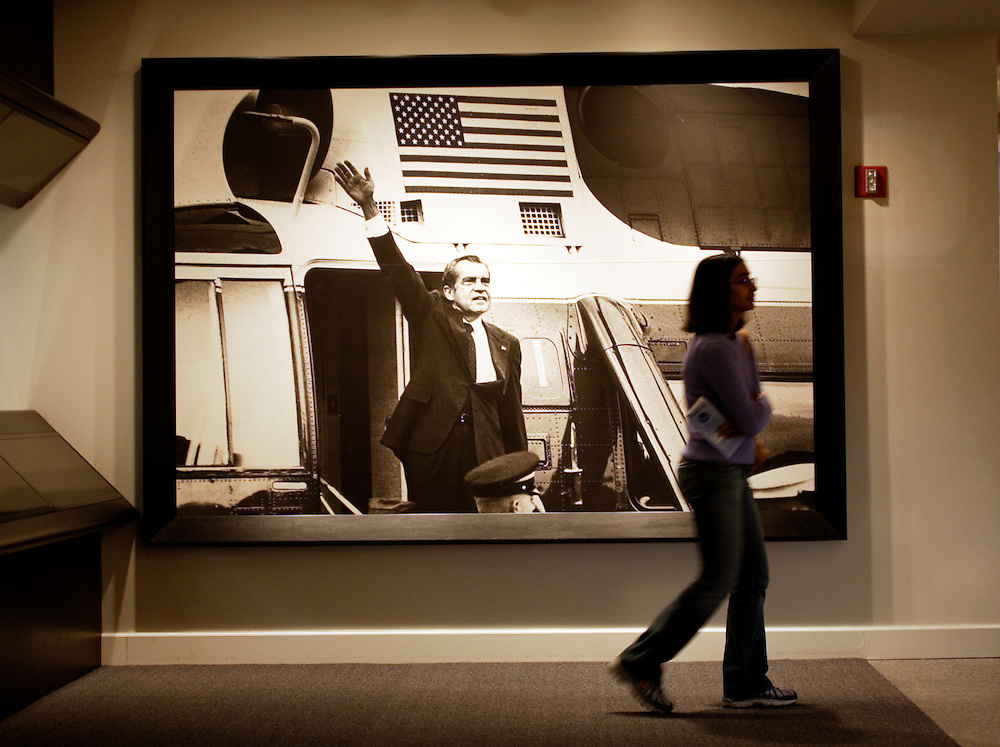 YORBA LINDA, CA, FEBRUARY 21, 2007: The Richard Nixon Library and Birthplace in Yorba Linda, California. A visitor strolls by an image of President Nixon that graces the wall in the Watergate exhibit. (Photograph by Todd Bigelow/Aurora)