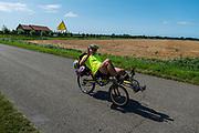 Ligfietsers rijden door de polder bij Haamstede.<br /> <br /> Recumbent cyclists ride at the polder near Haamstede.