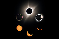 """The solar eclipse was absolutely incredible. There's no way to capture it in 1 picture or 1,000 pictures and there's nothing really to compare it to. During the minutes surrounding totality the light changed so fast and there was so much to observe and photograph that it was overwhelming. It felt like time stood still and yet it was all over in an instant. I listened to the dozens of people around me who also climbed the 10,276' Laramie Peak to observe this eclipse. Cheering and exclamations of """"WOW"""" were an almost involuntary reaction.<br /> <br /> This is a composite showing 3 partial phases of the eclipse with a solar filter, as well as 3 of the features that are visible during totality. A group of sunspots was visible before being hidden by the moon. The red fringes on the left are solar prominences. Bigger than any planet, prominences are made up of dynamic loops of hot plasma and will often explode. This outer atmosphere of the sun is sculpted by it's magnetic field. The temperature of the corona is up to 450 times hotter than the surface of the sun and no one knows why. At the top right is an effect known as the """"diamond ring."""" It is the moment the first bit of sun emerges from behind the moon. I was surprised by just how suddenly it popped out, with all the brightness of the sun concentrated into a single point."""