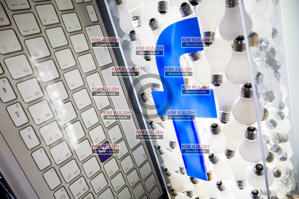 Scenes of daily work and life at Facebook', Inc. USA Headquarters in Menlo Park, California.  A Facebook logo on a lightbulb sculpture on display.b