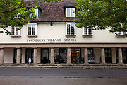 The Poundbury Village Stores - a traditionally styled building in Poundbury. Poundbury on Duchy of Cornwall land is Prince Charles' attempt to create an urban extension to Dorchester famed for Its pastiche of traditional architecture. Dorset, UK