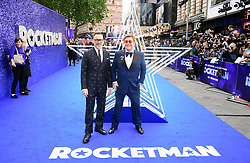 David Furnish and Elton John attending the Rocketman UK Premiere, at the Odeon Luxe, Leicester Square, London.