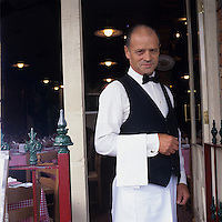 Australia, Victoria, Melbourne, (MR) Portrait of head waiter Eddy DeCrescendo, at Pasta Rustica in the Little Italy neighborhood