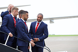 CARDIFF, WALES - Saturday, June 4, 2016: The Wales captain Ashley Williams jokes with team mates as the squad prepares for a team photograph on the steps of the aircraft as they are given a send off at Cardiff Airport as they head to Sweden for their last friendly before the UEFA Euro 2016 in France. (Pic by Paul Greenwood/Propaganda)