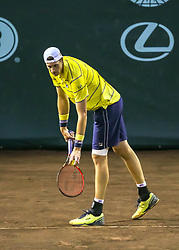 April 13, 2018 - Houston, TX, U.S. - HOUSTON, TX - APRIL 13:  John Isner of the United States prepares to serve in the match against Steve Johnson of the United States during the Quarterfinal round of the Men's Clay Court Championship on April 13, 2018 at River Oaks Country Club in Houston, Texas.  (Photo by Leslie Plaza Johnson/Icon Sportswire) (Credit Image: © Leslie Plaza Johnson/Icon SMI via ZUMA Press)