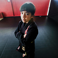 032913      Adron Gardner<br /> <br /> Mixed martial artist and wrestler Amy Mitchell strikes a pose in her gi at  Nayee'eji Fierce MMA/Jiu-Jitsu in Gallup Friday.
