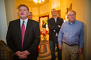 "03 AUGUST 2012 - GILBERT, AZ:   WIL CARDON (left) stands among Republican voters during a ""meet & greet"" in a private home in Gilbert, AZ, Friday. Cardon, a wealthy businessman, is running in the Republican primary for the US Senate seat being vacated by Sen. Jon Kyl. He is running against long serving Congressman Jeff Flake, who currently represents Arizona's 6th Congressional District, a conservative, largely Mormon, district in the suburbs of Phoenix. Both Cardon and Flake are active Mormons and both men are running as ""Tea Party"" inspired conservatives. Whoever wins the August 28 primary will face Dr. Richard Carmona in November's general election.  PHOTO BY JACK KURTZ"