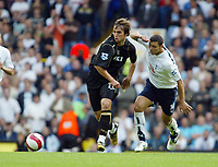 Photo: Chris Ratcliffe.<br /> Tottenham Hotspur v Portsmouth. The Barclays Premiership. 01/10/2006.<br /> Niko Kranjcar of Portsmouth clashes with Hossam Ghaly of Spurs.