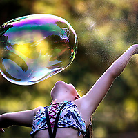 A youngster exults during bubble time at Hospice of Santa Cruz County's Camp Erin at Mount Hermon Camp in Mount Hermon, California on October 7, 2017. Camp Erin is a national program to provide a safe and nurturing weekend to children who have lost a loved one<br /> Photo by Shmuel Thaler <br /> shmuel_thaler@yahoo.com www.shmuelthaler.com