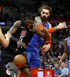 March 8, 2019 - Los Angeles, California, U.S - Los Angeles Clippers' Montrezl Harrell (5) and Oklahoma City Thunder's Steven Adams (12) battle for a ball during an NBA basketball game between Los Angeles Clippers and Oklahoma City Thunder Friday, March 8, 2019, in Los Angeles. (Credit Image: © Ringo Chiu/ZUMA Wire)