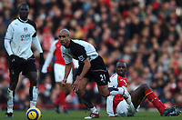 Photo: Javier Garcia/Back Page Images<br />Arsenal v Fulham, FA Barclays Premiership, Highbury, 26/12/04<br />Papa Boupa Diop, left and Patrick Vieira look on as Zesh Rehman comes away with the ball