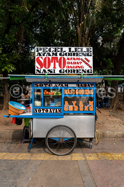 Brightly coloured street food carts in Central Jakarta near Merdeka Square on the 2nd November 2019 in Java in Indonesia.