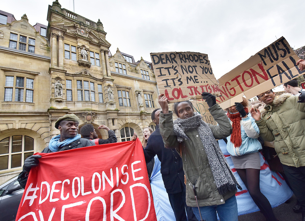 © Licensed to London News Pictures. 09/03/2016 The demo passes beneath the Statue of Cecil Rhodes on the front of Oriel College on the Hight street in Oxford. Speeches and songs. Rhodes must fall demonstration and march through Oxford. Protest outside Oriel College followed by a march through the streets of Oxford. Photo credit : MARK HEMSWORTH/LNP