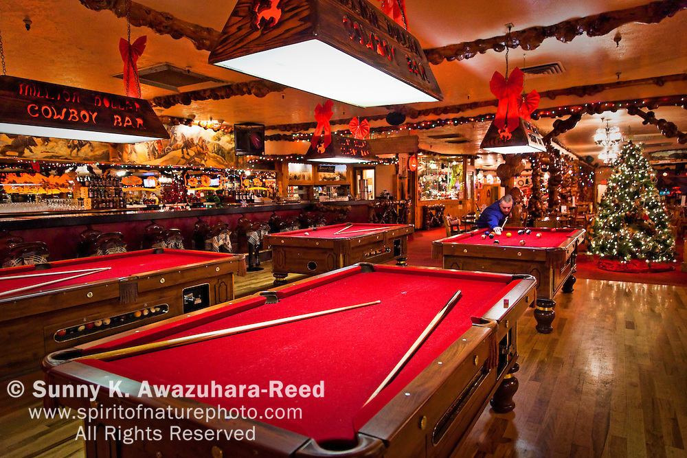 Pool Tables.  The interior of The Million Dollar Cowboy Bar in Jackson Hole, WY.  Christmas Decoration.