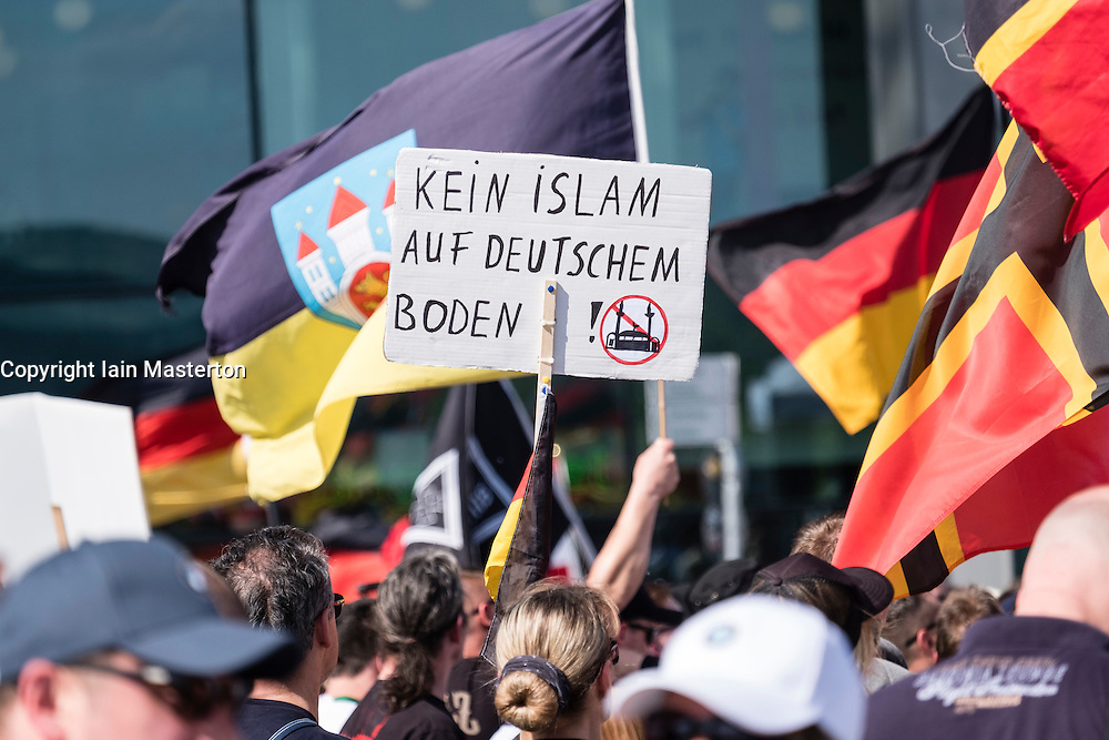 "Berlin, Germany. 7th May 2016. Far-right protesters demonstrate against islam, refugees and Angela Merkel in Mitte Berlin. Protestors demanded that Chancellor Angela Merkel stand down because of allowing large numbers of refugees and migrants to enter Germany. This sign says ""no islam on German soil""."