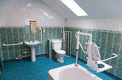 A bathroom equipped with facilities for disabled older people of a warden aided complex,
