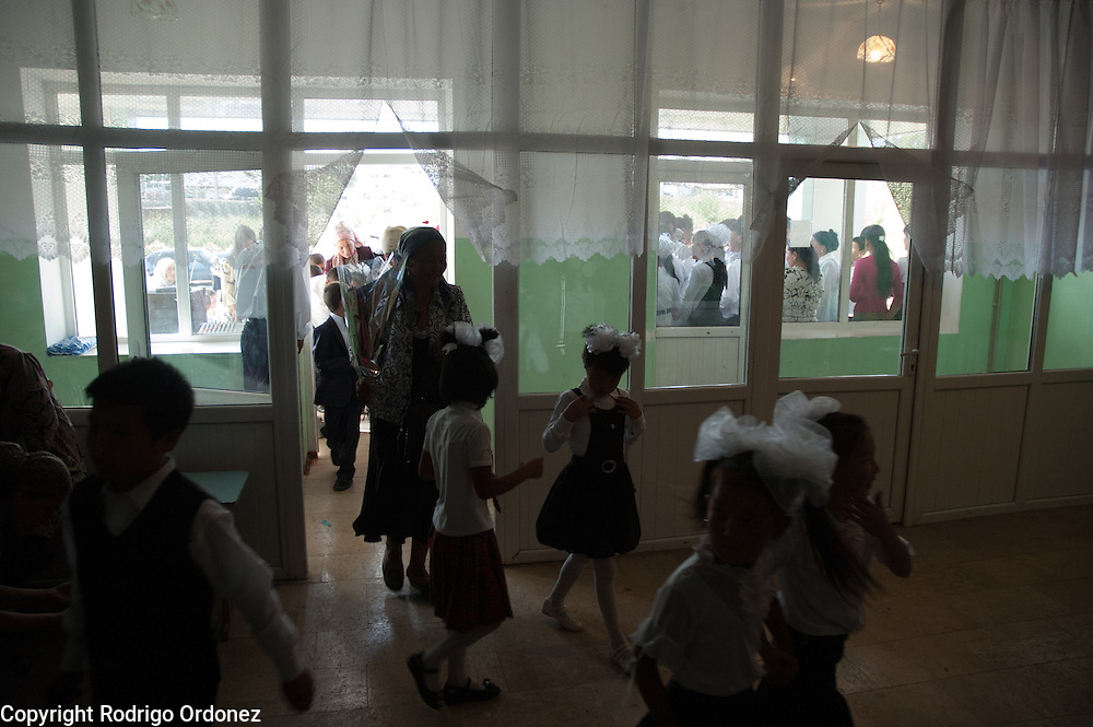 Children in uniform enter Mombekova School (in Osh, Kyrgyzstan) during the ceremony to mark the 'first bell', or first day of school, on September 1, 2010.