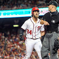 WASHINGTON, DC - JULY 26: Washington Nationals right fielder Bryce Harper (34) throws his bat and is ejected from the game by home plate umpire Chris Segal (96) after striking out during an MLB game between the Atlanta Braves and the Washington Nationals on July 26, 2017, at Nationals Park in Washington, D.C. The Washington Nationals defeated the Milwaukee Brewers, 8-5. (Photo by Mark Goldman/Icon Sportswire)
