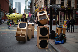 © Licensed to London News Pictures. 30/08/2019. Manchester, UK. A sound system is set up on Deansgate . Extinction Rebellion block roads during the rush hour , in Manchester City Centre , at the start of several days of planned disruption organised by environmental campaigners . Manchester City Council has declared a climate emergency but activists say the council's development plans do not reflect this . Photo credit: Joel Goodman/LNP