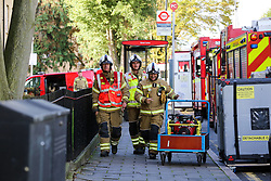 © Licensed to London News Pictures. 08/10/2019. London, UK. Emergency services are on the scene following a burst water main on Brownswood Road in Finsbury Park, north London. Photo credit: Dinendra Haria/LNP