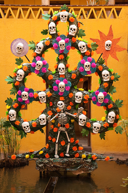 North America, Mexico, Oaxaca Province, Oaxaca, elaborate skull and flower sculpture in courtyard, Day of the Dead (Dias de los Muertos) celebration