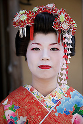 Asia, Japan, Honshu island, Kyoto, Gion district, Geisha in kimono with flowers adorning hair