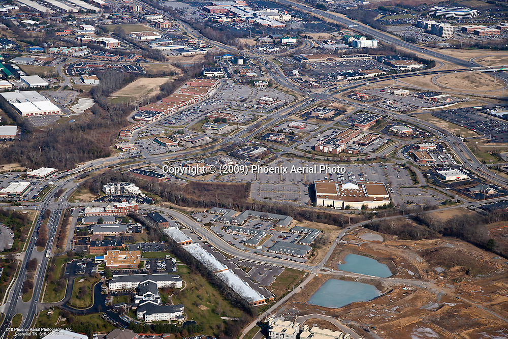 Aerial photo of the intersection of Cool Springs Boulevard and Aspen Grove Drive showing CoolSprings Mall and Interstate 65 in the background.