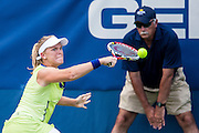 USA's Melanie Oudin hits a return to Germany's Angelique Kerber during their women's singles match at the Citi Open ATP tennis tournament in Washington, DC, USA, 1 Aug 2013. Kerber won the match 7-5, 6-0 to advance.