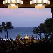 KAUAI, HI, July 14, 2007: Entertainers perform at sunset at the Hyatt Regency Resort and Spa on island of Kauai in Hawaii. (Photograph by Todd Bigelow/Aurora)