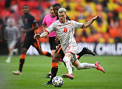 AMSTERDAM, NETHERLANDS - JUNE 21: Egzijan Alioski of North Macedonia is tackled by Georginio Wijnaldum of Netherlands  during the UEFA Euro 2020 Championship Group C match between North Macedonia and The Netherlands at Johan Cruijff Arena on June 21, 2021 in Amsterdam, Netherlands. (Photo by Lukas Schulze - UEFA)