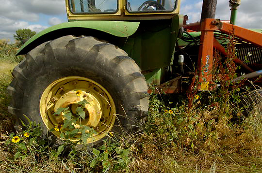 Farm equipment and field near Charles M. Russell National Wildlife Refuge. Montana. Summer.
