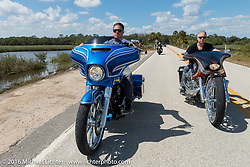 Zach Ness riding riding in Tamoka State Park with his father Cory Ness on his side-by-side twin engine custom and grandpa Arlen Ness in the back during the Daytona Bike Week 75th Anniversary event. FL, USA. Monday March 7, 2016.  Photography ©2016 Michael Lichter.