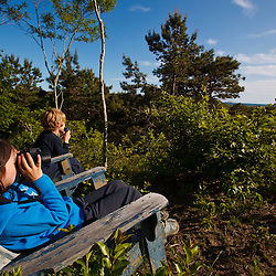 A young boy and girl take in the view from the Biddle Property in Wellfleet, Massachusetts. Cape Cod National Seacshore.