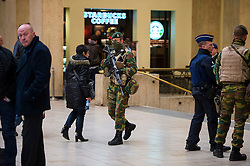 "© Licensed to London News Pictures. 23/11/2015. Brussels, Belgium. Belgian military patrolling Brussels Central Station  where the city is currently on ""lockdown"" amid ""imminent threat"" of Paris-style bomb and gun attacks. Photo credit: Ben Cawthra/LNP"