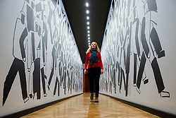 """© Licensed to London News Pictures. 07/02/2017. London, UK. A staff member views """"At The Parade"""" by Vladmir Krinksy at the preview of an exhibition entitled """"Revolution Russian Art 1917-1932"""", which marks the centenary of the Russian Revolution.  The exhibition runs from 11 February to 17 April 2017 at the Royal Academy of Arts in Piccadilly. Photo credit : Stephen Chung/LNP"""