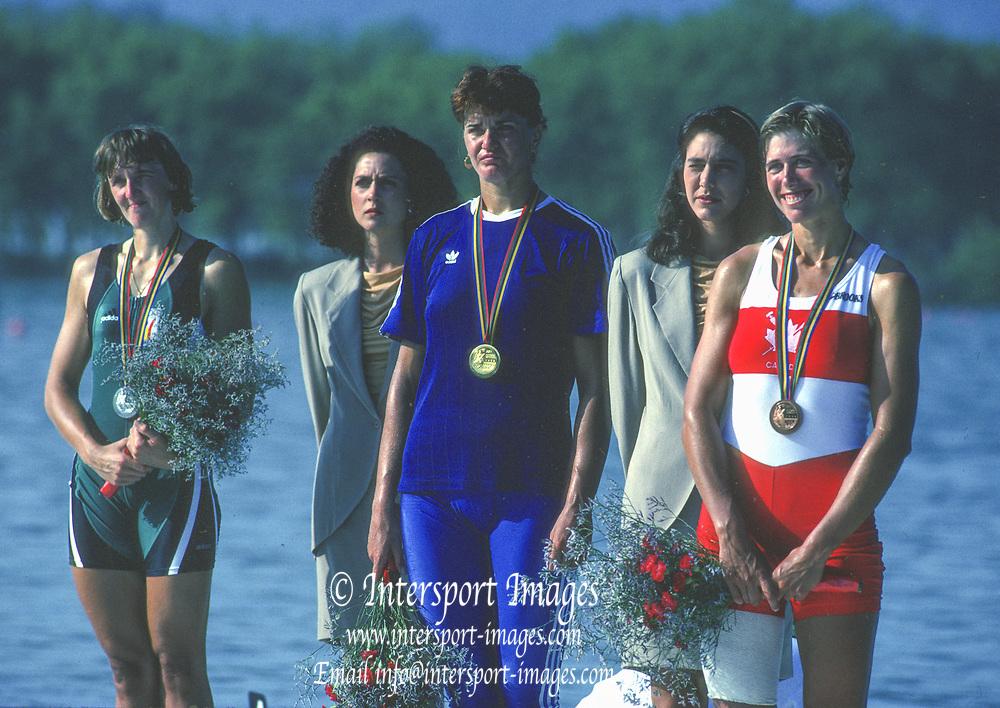 Barcelona Olympic Games 1992<br /> Olympic Regatta - Lake Banyoles<br /> left to Right, Silver Medalist, BEL W1X, Ann Elise BREDAEL, Gold Medalist, ROU W1X,  Elisabeta LIPA-OLENIUC and CAN W1X, Silken LAUMANN  on awards dock.; Women's Single Medals,  {Mandatory Credit: © Peter Spurrier/Intersport Images]