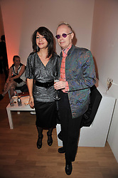 YELENA OOSTING and ANTHONY FAWCETT at the TOD'S Art Plus Drama Party at the Whitechapel Gallery, London on 24th March 2011.