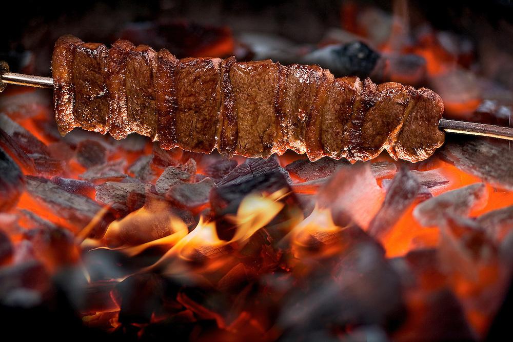 brazillian steak roasting on spit