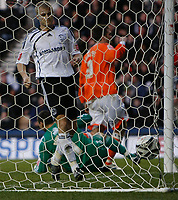 Photo: Steve Bond/Richard Lane Photography. Derby County v Blackpool. Coca-Cola Championship. 26/12/2009. Jay McEveley (L) looks back as the ball hits the back of the net. Keeper Stephen Bywater is beaten by Brett Ormerod,