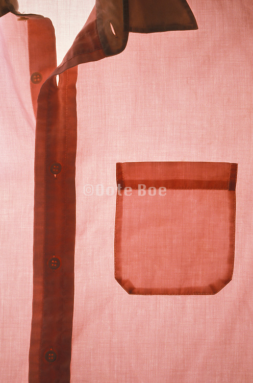 detail of men?s button down red shirt