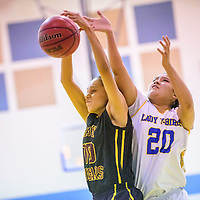 Tohatchi Cougar Crystal Haley (10) and Zuni Thunderbird Courtney Lementino (20) vie for a rebound in Zuni Thursday.