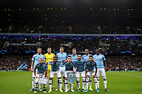 Football - 2019 / 2020 UEFA Champions League - Group C: Manchester City vs. Atalanta<br /> <br /> Manchester City players like up for a team group photograph before kick off.<br /> Pictured are Back row L-R: Kyle Walker, Ederson, Rodri, Kevin De Bruyne, Fernandinho, Benjamin Mendy.<br /> Front row L-R: Sergio Aguero, Raheem Sterling, Phil Foden, Ilkay Gundogan, Riyad Mahrez, at the Etihad Stadium.<br /> <br /> COLORSPORT/PAUL GREENWOOD