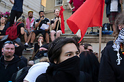 Demonstrators wearing masks gather to oppose the Free Tommy Robinson demonstration, organised by anti-fascist groups including Stand up to Racism opposed to far right politics on 24th August 2019 in London, United Kingdom. Some 250 Stand Up To Racism and other anti-fascist groups took to the streets today in opposition to supporters of jailed 'Tommy Robinson' real name Stephen Yaxley-Lennon at Oxford Circus, who gathered outside the BBC.