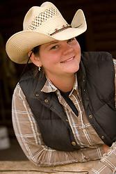 United States, Montana, Livingston, female wrangler in barn. MR
