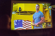 """Merrick, New York, USA. June 11, 2017.  American Grit TV show contestant CHRIS EDOM (wearing white """"got grit?"""" T-shirt), 48, of Merrick, hosts Viewing Party for Season 2 premiere. Show stresses teamwork and stars WWE star John Cena. Edom family's relatives and neighbors watched Episode 1 of the Fox network TV show on large screen in their backyard. Edom was the last of 16 contestants picked for a team, each which has a military mentor."""