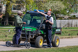 © Licensed to London News Pictures. 21/04/2020. London, UK. A Policeman speaks to a man on an electric scooter where cycling and driving have been banned in the park since lockdown. Police patrol Richmond Park enforcing lockdown rules with a Police 4x4 buggy which is one of only four originally built for the Olympics and now used during the pandemic in the Royal park for its off-road capabilities. Photo credit: Alex Lentati/LNP