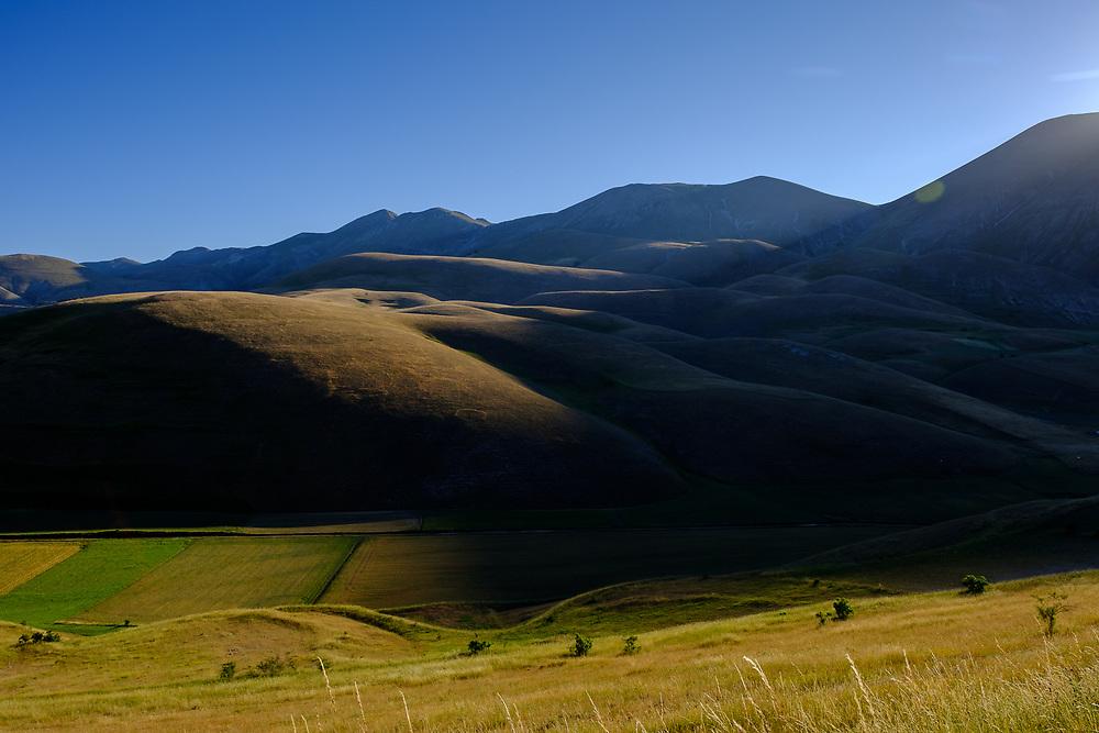 Pian Perduto and the Sibillini Mountains near Castelluccio in the Italian region of Umbria.