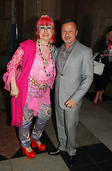 Designers ZANDRA RHODES and JACQUES AZAGURY at a party at the V&A museum, Cromwell Road, London for three exhibitions - Sixties Fashion, Sixties Graphics and Che Guevara:Revolutionary and icon held on 5th June 2006.<br /><br />NON EXCLUSIVE - WORLD RIGHTS