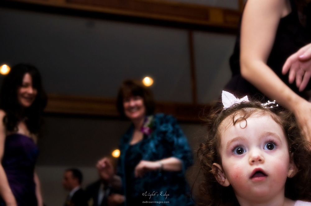 This cutie was mesmerized as the adults took to the dance floor following the post wedding dinner.